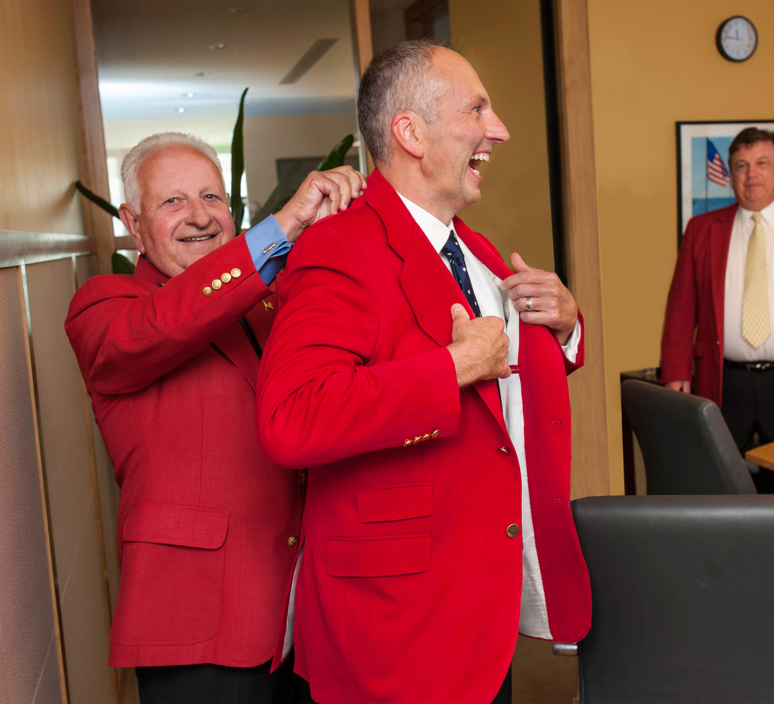 Jason receives his official red blazer from 1981 Ringmaster, his dad Andrew Julian.